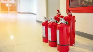 red tank fire extinguisher is powerful industrial concepts emergency safety equipment fire prevention